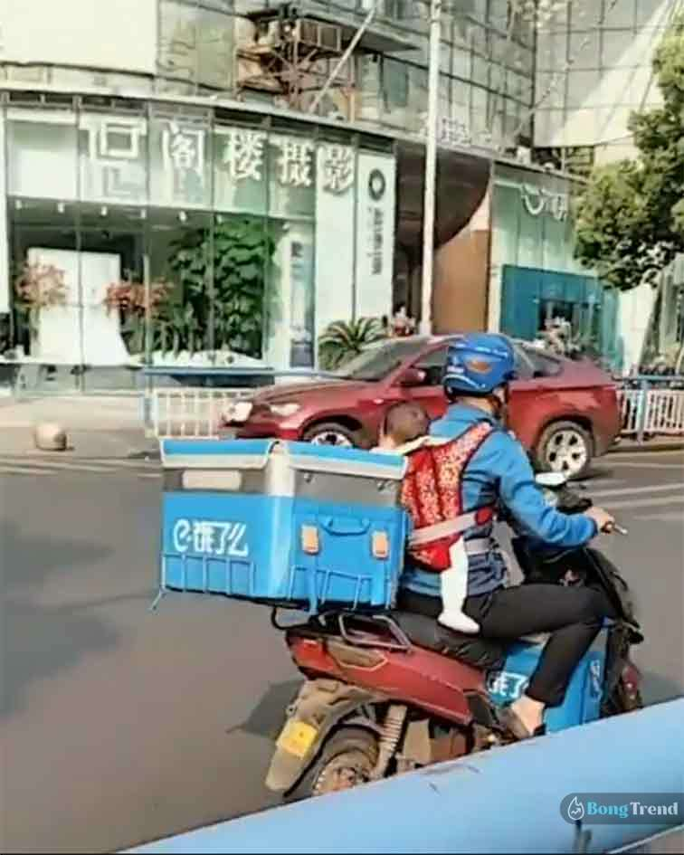 Delivery Boy with baby in Scooty