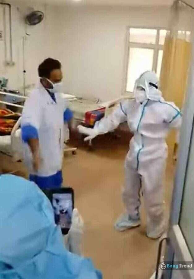 Nurse dancing in PPE Kit